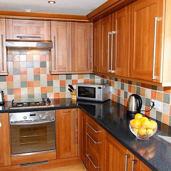 coral-kitchen open plan kitchen with added bonus of WM and dryer