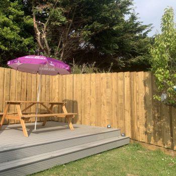 Outside decked area, private sunny garden