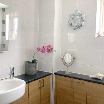 Main bathroom shower over bath heated towel rail