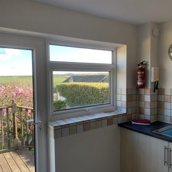 Kitchen with door onto decking and garden