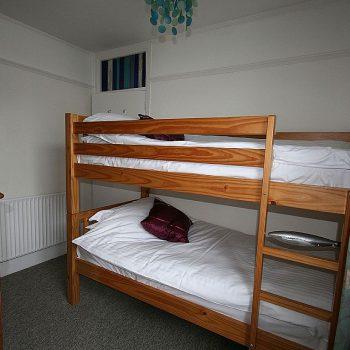 Beach View bedroom 3 links to bunk room